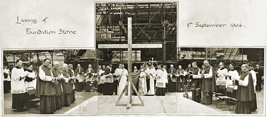"""""""Archbishop Scanlan laying the foundation stone before the 'entire hierarchy of Scotland', 8 September 1964. In central group, immediately to the left of cross: Professor James McShane (in white) and Rector Connolly. In left hand group, front row: Archbishop Grey (left) with Bishop McGhee of Galloway behind. In right hand group, front row, from left: Bishop Ward, Bishop Hart of Dunkeld, Bishop Black of Paisley, in right hand group, at centre of back row: Father James McMahon."""""""