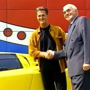 Bugatti Automobili CEO Romano Artioli shakes hands with the EB110's most famous owner, Michael Schumacher, in 1994.