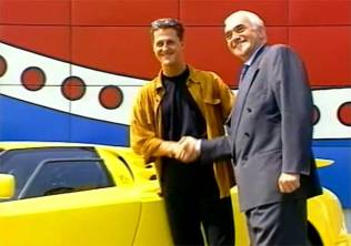 Bugatti Automobili CEO Romano Artioli shakes hands with the EB110's most famous owner, Michael Schumacher, in 1994.