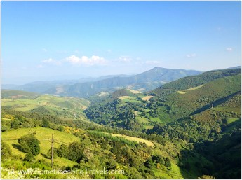 Vista of green mountains, hills, and valleys