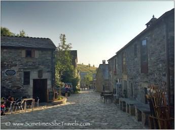 Stone village in Spain with cobblestone street.