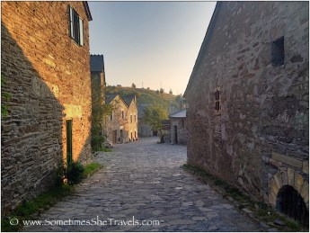 Stone houses in Spanish village with cobblestone street.
