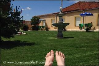 feet, grass, and fountain