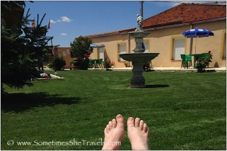 feet, grass, and fountain
