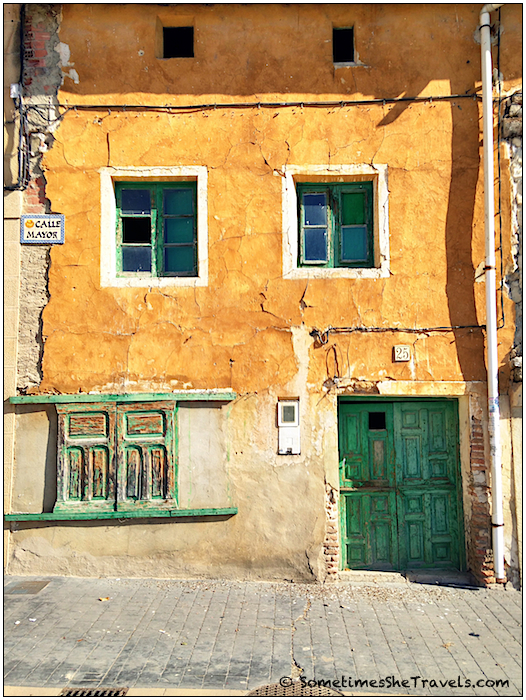 Yellow wall, green door