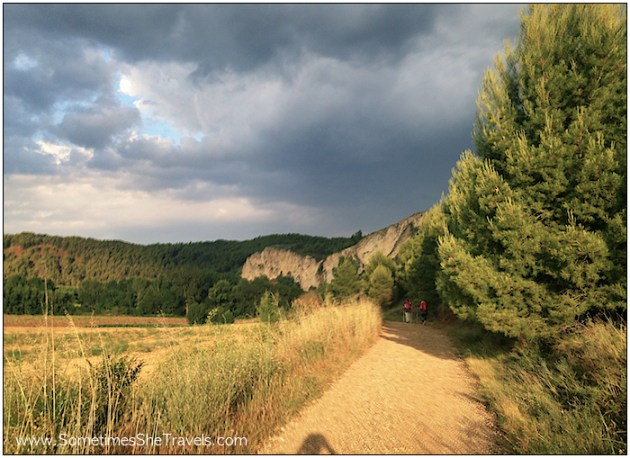 dirt trail, storm clouds, cliffs