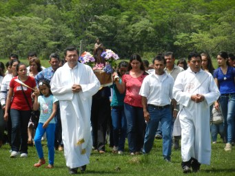 Fiesta Patronal 2014; at the end of morning mass the priests lead the march around the soccer field with locals carrying a figure of St. Francis. A very solemn occasion save for the occasional fireworks.