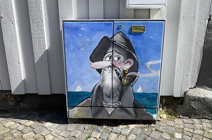 Elektrisch huisje beschildering rokende visser - sommarmorgon.com