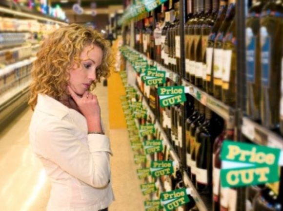 Person selecting bottle of wine