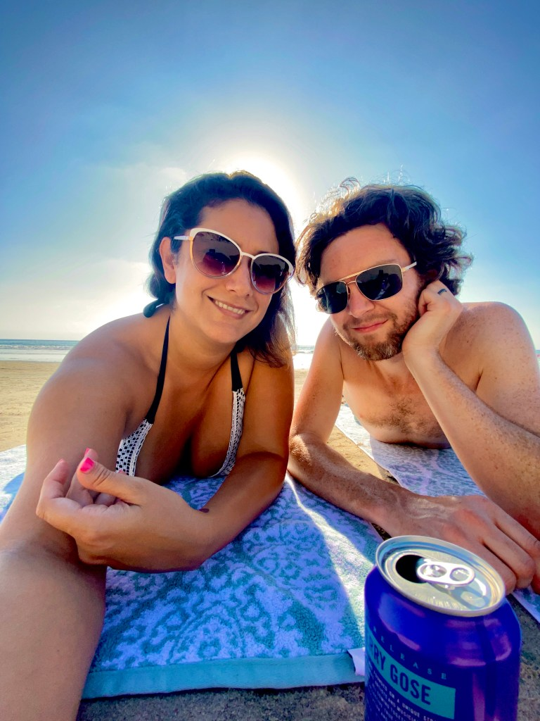 A young mixed race couple enjoying the beach in Carsbad