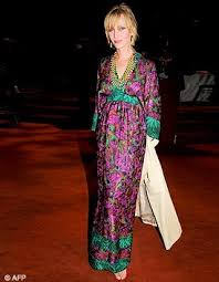 Uma Thurman wearing a colorful Moroccan Caftan, Photo Credit: AFP
