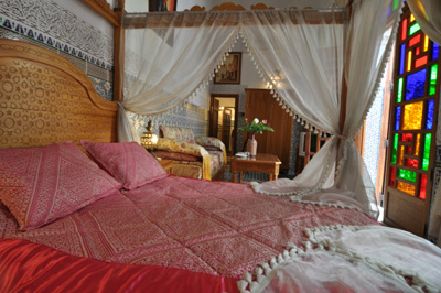 Hand embroidered moroccan bed, Riad Ghita, Morocco