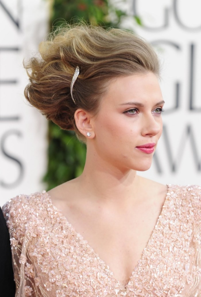 Scarlett Johansson uses Moroccan oil to soften her hair. Image Source: cosmeticandbeautyreviews.wordpress.com