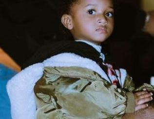 Check Out This Adorable Video Of Wizkid Teaching Zion How To Eat Pounded Yam