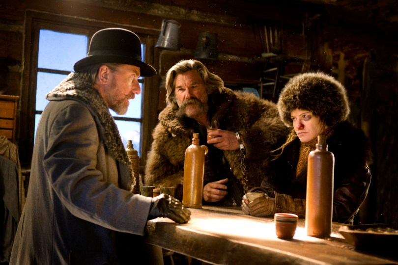 (L-R) TIM ROTH, KURT RUSSELL, and JENNIFER JASON LEIGH star in THE HATEFUL EIGHT. Photo: Andrew Cooper, SMPSP © 2015 The Weinstein Company. All Rights Reserved.