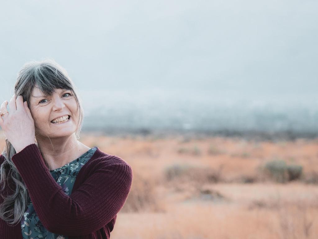 Josephine smiling in the desert