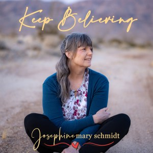 Josephine Mary Schmidt sitting on the ground in the desert of Palm Springs