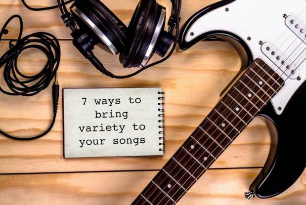 electric guitar, headphones, and notebook on the floor with the caption 7 ways to bring variety to your songs