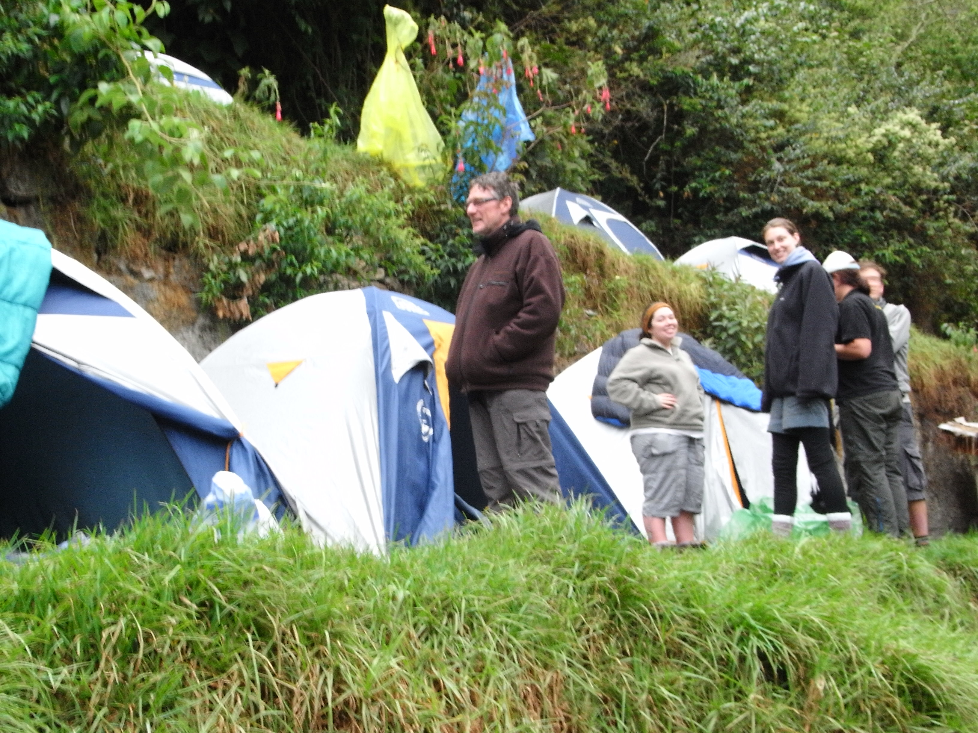 a brief break in the rain reveals the Gordon camping on an Andes terrace