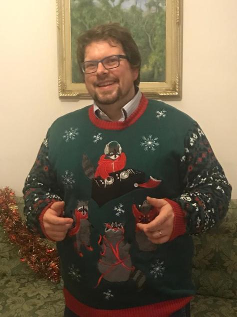 dj raccoon sweater