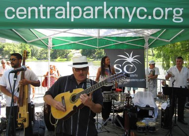 JuanMa-playing-cuatro-emotive-black-guayabera-panam-hat-band-Central-Park-NYC-Meers