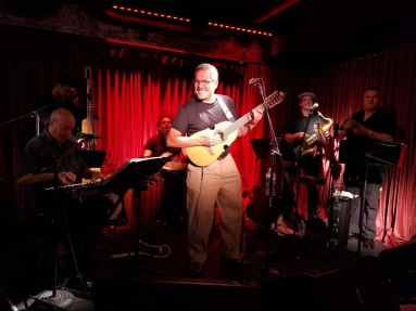 JuanMa-playing-cuatro-smiling-conga-bass-sax-trumpet-piano-Subrosa-Blue-Note-Group-Highline-ballroom-club-NYC