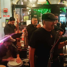 JuanMa-singing-beret-hat-band-action-Havana-Centra-Times-Square-restaurant