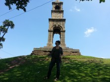 Posing for old monument.