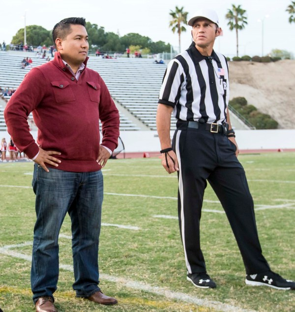 Trustee Agbalog getting ready for coin toss Oct 22 2016.jpg