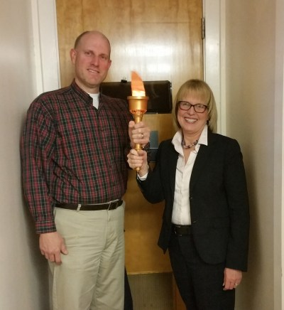Liz passing the torch to Jason