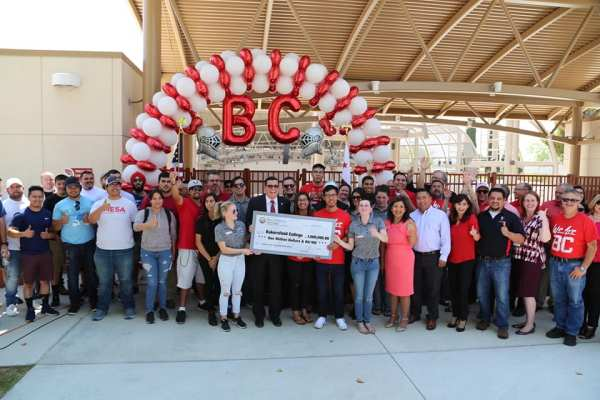 Assemblymember Rudy Salas presents check to BC students and faculty.