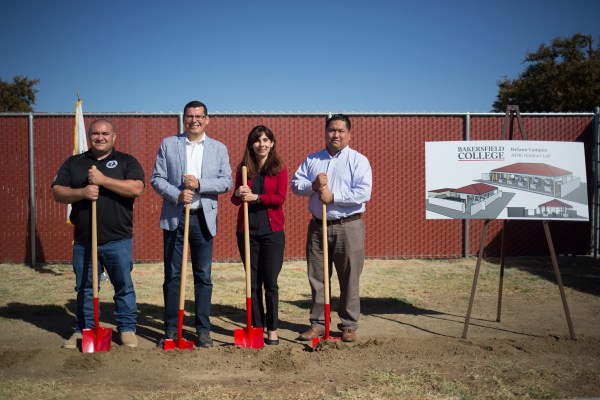 Rudy Salas, Sonya Christian, Trustee Agbalog and a HVAC faculty breaking ground with red shovels.