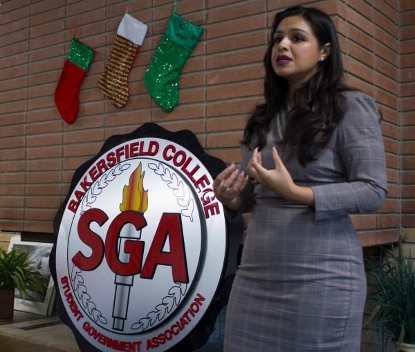 Trejo speaking in front of the SGA sign.