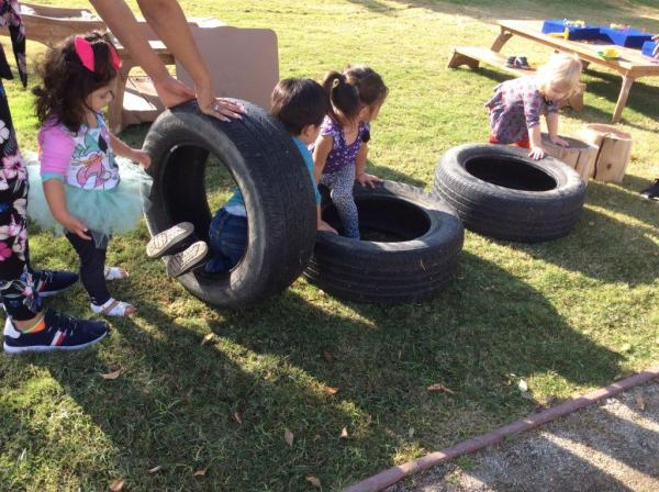 Children playing with tires