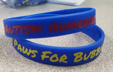 Autism Awareness on plastic bracelets.