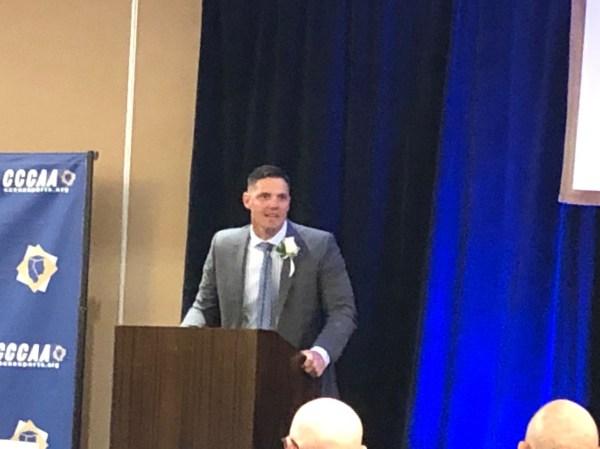 Jeremy speaking at podium.