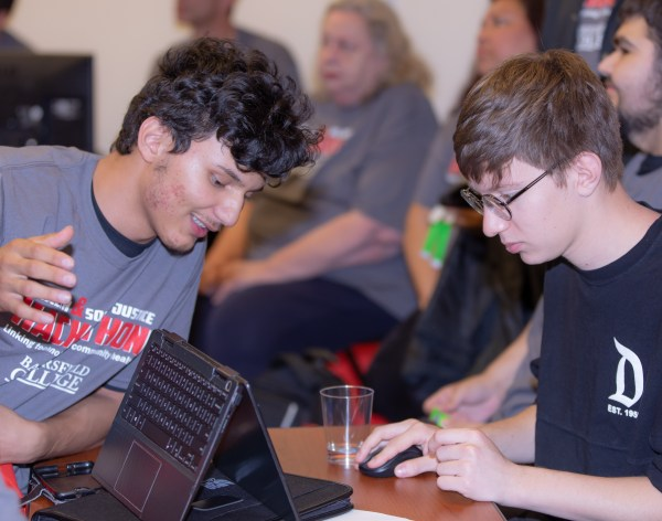 Students hacking on a computer