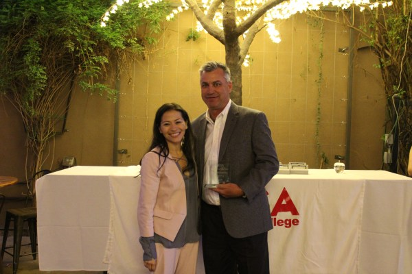 Connie poses with a male award recipient.