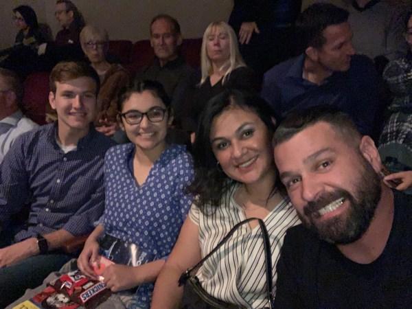 Manny De Los Santos, his wife, daughter, and her boyfriend in their seats