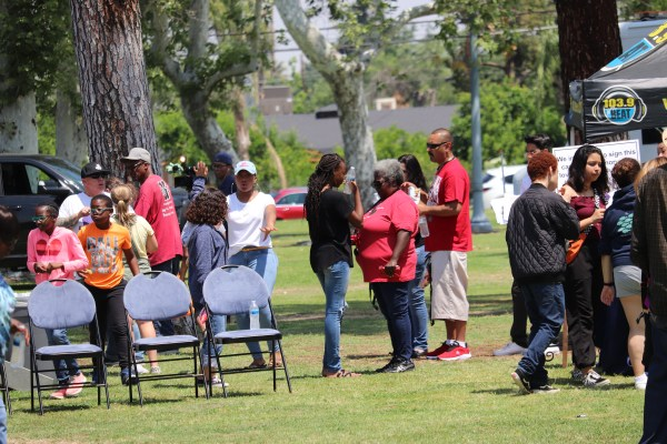 Audience mingling in park.