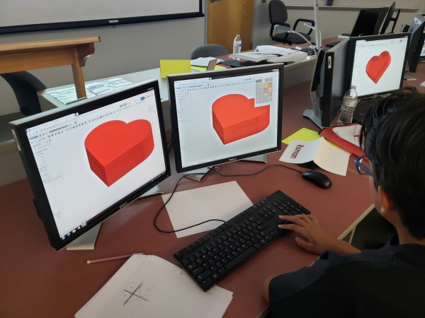 Student works with a computer application to design a heart to print in 3D.