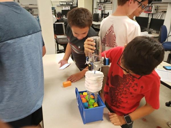 Student assembling mobile app component.