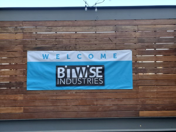 Welcome Bitwise Industries Banner on wooden wall.