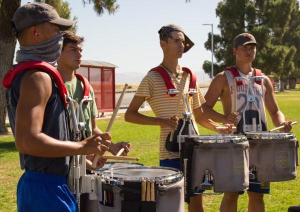 Snare drummers drumming.