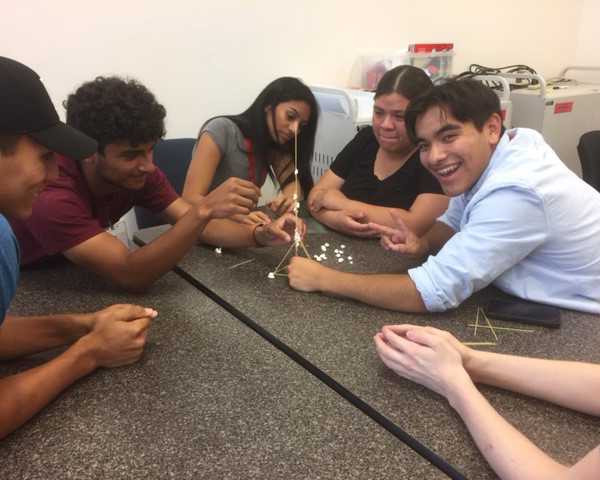 Summer bridge students building tower with marshmallows and spaghetti