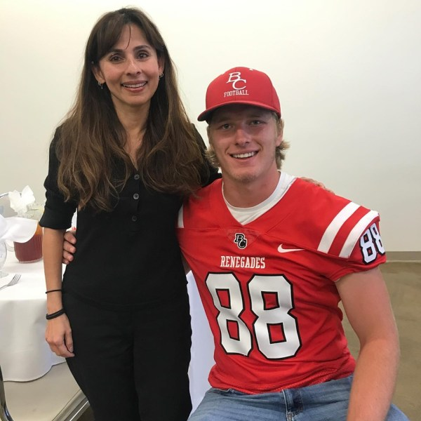 Sonya and a football player in jersey.