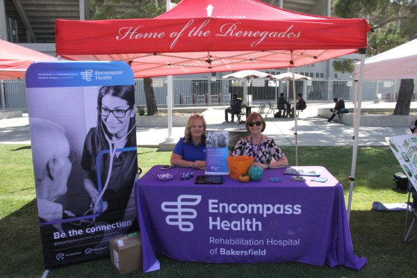 Encompass Health both with friendly reps and a large poster for Be the Connection.