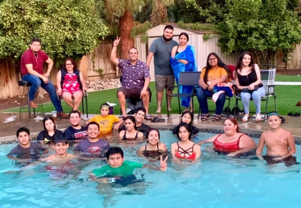 Students in and around a swimming pool.