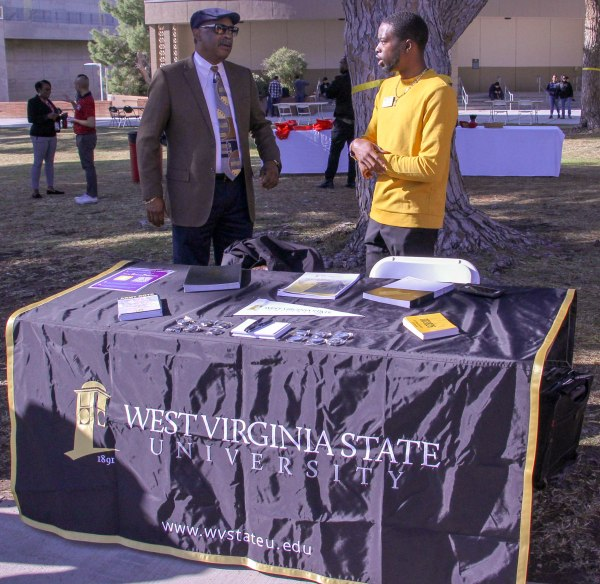 Rep from West Virginia State University table.