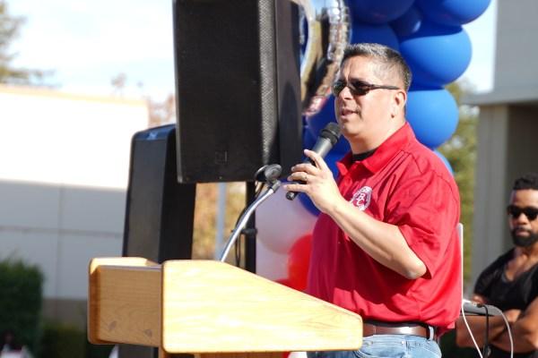 Speaking at the podium.